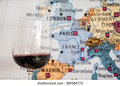 glass of wine near map