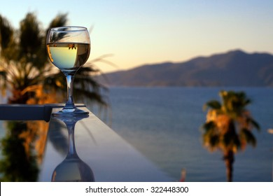 A glass of wine on the background of the sea