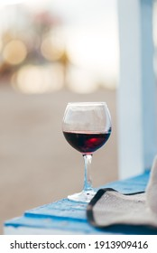 glass of wine on the beach