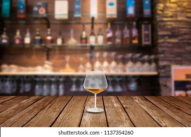 Glass of wine on table in bar