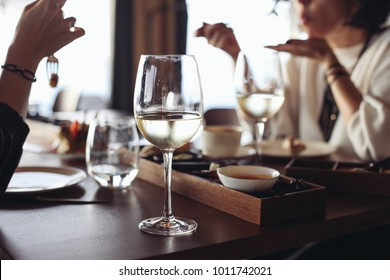 A glass of wine on a table in a restaurnt