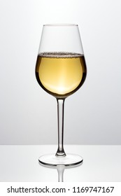 Glass of wine in a glass on a white background