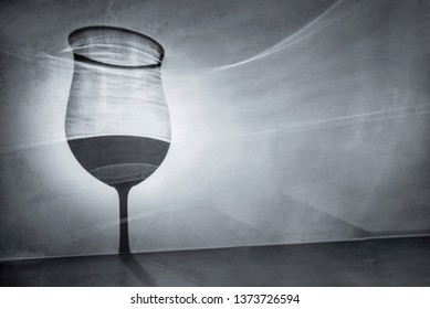 Glass of wine as a shadow on gray background