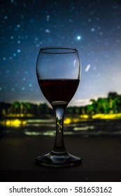 Glass of wine with stars on background