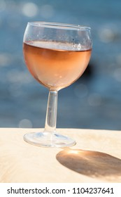 glass of rosé wine in the sun