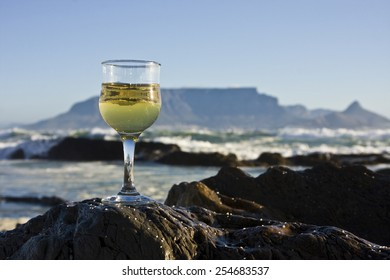 Glass of wine with Table mountain in the background.
