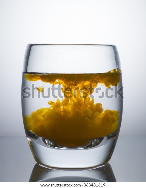 Glass Yellow Food Coloring Drops Stock Photo (Edit Now ...