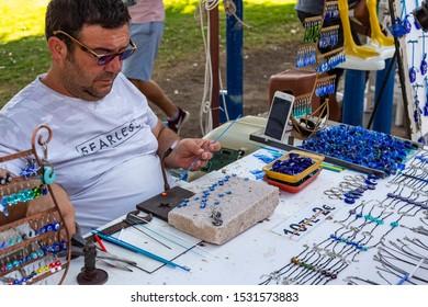 Glassblower artist on the street in Bodrum. Turkey, July 2019