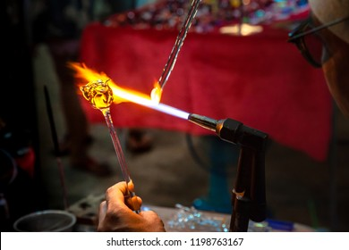 Glassblower made Handicraft from melted glass roses Shaped at the end of glassblowing pipe.