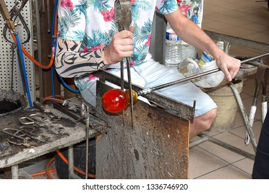 glassblower in the workshop