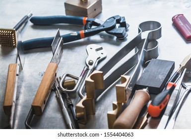 Glassblowing hand tools. Lampworker workshop. Glass on fire.