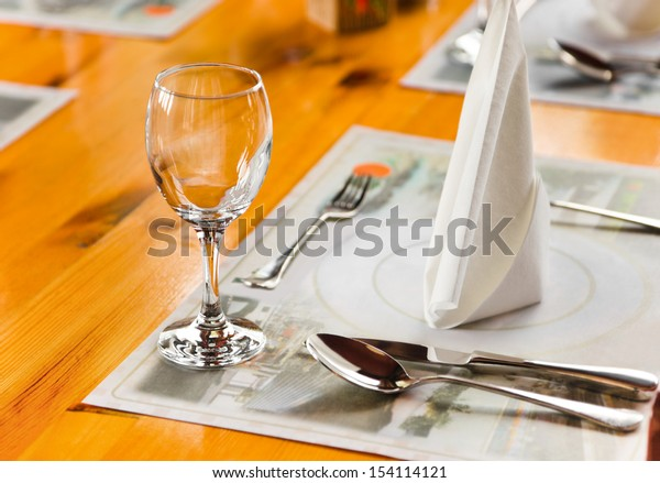 Glasse and plate on table in restaurant - food background
