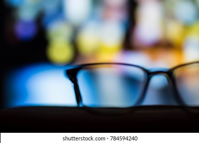 Glasses against the colorful background