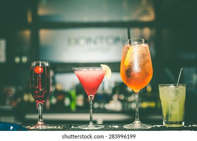 Glasses with alcohol drink on the bar