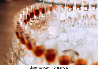 glasses with alcoholic beverages on a transparent stand. close up