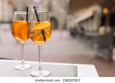 Glasses of Aperitif drink on the terrace table of a restaurant in the old town. Lifestyle concept, space for text.
