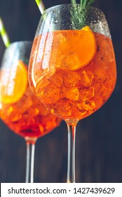 Glasses of Aperol Spritz cocktail on the rustic background
