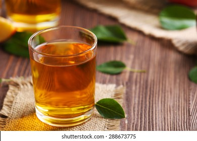 Glasses of apple juice on table close up