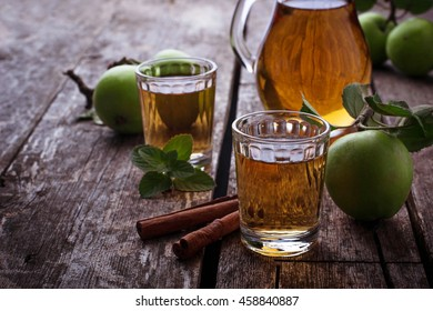 Glasses with apple juice on wooden table. Selective focus