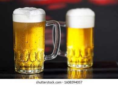 Glasses of beer on the dark background
