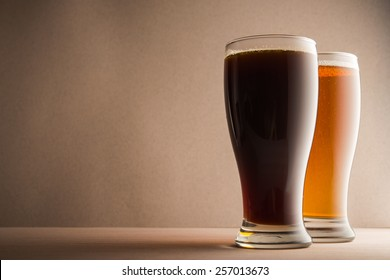 Glasses of beer on wood table
