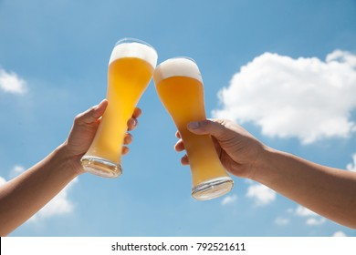 Glasses  of beer with sky