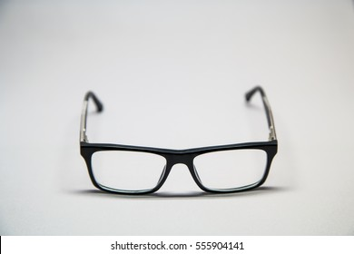 Glasses with a black frame on white background