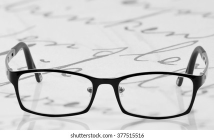 glasses with black frames on white background