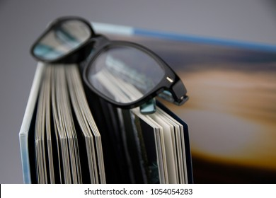glasses at a book