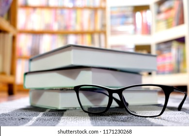 Glasses and books Placed at the library Educational and academic Ideas
