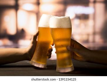 Glasses and bottles of refreshing beer