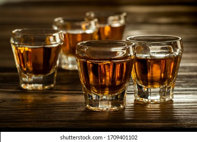 glasses with brandy on the table, strong alcoholic drinks