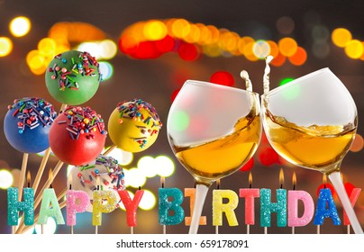 Glasses, candy and festive candles on abstract background