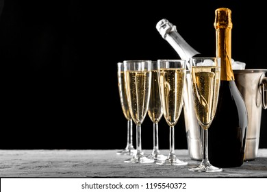 glasses of champagne with a champagne bottle in a bucket