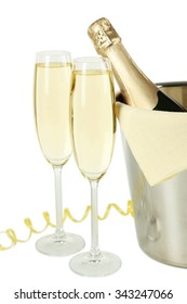Glasses of champagne with bottle in a bucket on white background