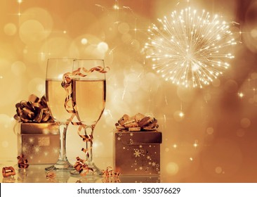 Glasses with champagne and Christmas decoration on winter background