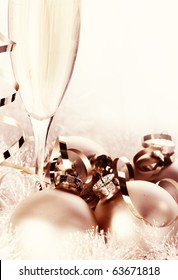 Glasses of champagne and Christmas ornaments