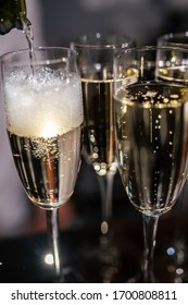 Glasses with champagne close-up. Champagne is poured into a glass