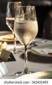 Glasses of champagne in holiday setting, served on table.