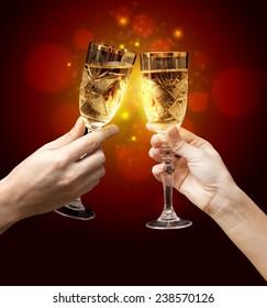 Glasses of champagne on dark background