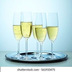 glasses of champagne on metallic plate