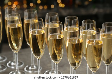Glasses of champagne on table against blurred background