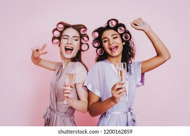Glasses Champagne. Pink Background. Celebrating Women's Day. Two Emotional Women. Happy Emotions Woman. International Party. Beautiful Girl. Womans Emotion. Girls with Champagne. Women in Bathrobes.