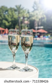 Glasses of champagne in the pool