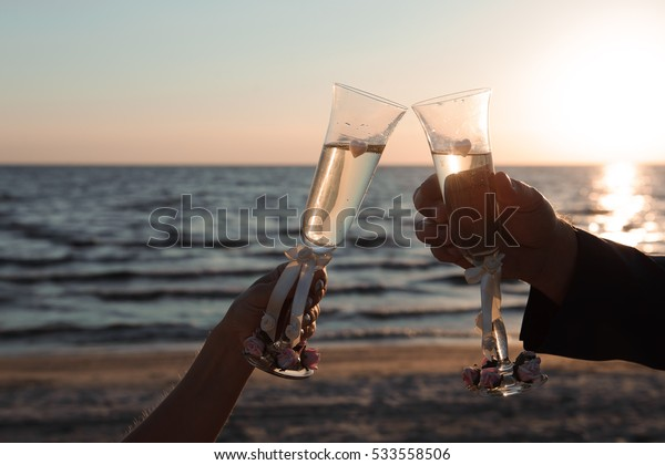 Glasses of champagne at the seaside - wedding ceremony decoration