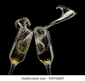 Glasses of champagne with splashes on a black background