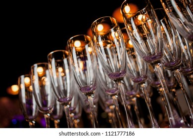 glasses with champagne stand on the bar. Sparkling wine glasses champagne stand in row at the bar, catering. Champagne glasses at the party.  close up photo, soft focus. Meeting the guests.