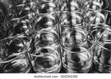 Glasses / Glasses for champagne / wine, stand on a table. wedding party. close up photo, soft focus. Black and white photo
