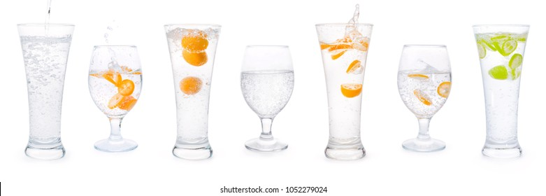 Glasses with clear sparkling water, citrus fruits splashes and bubbles set. Isolated on white, clipping path included