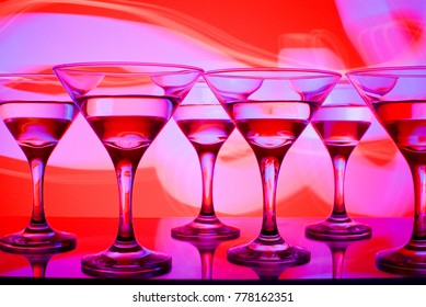 glasses with cocktail in a nightclub entourage